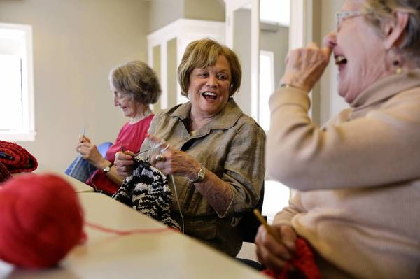 Judy Demain, Judy Kipnis and Sylvia Dennis, from left, joke while knitting blankets at the Highland Park Senior Center, 54 Laurel Ave., on April 30.