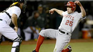 OAKLAND — The Angels, as expected, put center fielder Peter Bourjos on the 15-day disabled list Tuesday because of a left hamstring strain and activated shortstop Erick Aybar, who is in the lineup and leading off for Tuesday night's game against the Oakland Athletics. Aybar had been on the DL because of a left heel bruise.