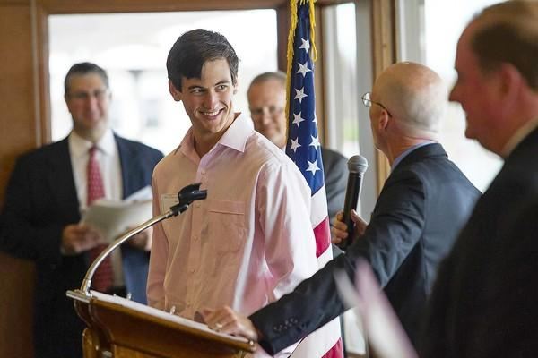 Newport Harbor High School's Cameron Geehr is introduced by the school's Assistant Principal Jack Cusick during the 52nd Annual Scholarship Awards Breakfast at the Bahia Corinthian Yacht Club on Tuesday.