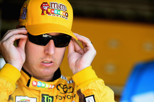 Kyle Busch, driver of the #18 M&M's Toyota, dons his sunglasses during practice for the NASCAR Sprint Cup Series Toyota Owners 400 at Richmond International Raceway.