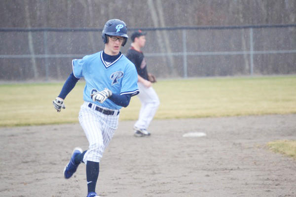 Petoskey's Kenny Gray rounds third base during the Northmen's opening game against Cheboygan at the Cheboygan High School baseball field. The Northmen defeated the Chiefs, 3-2; and then played to a 1-1 tie.
