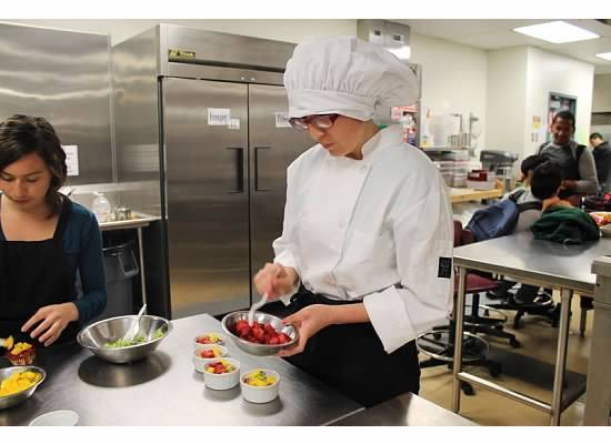 "L.A. ninth-grader Guadalupe Gonzales prepares her ""Breakfast Fruit Puff,"" which took the top prize in an L.A. Unified breakfast recipe contest. She used whole wheat flour to make the recipe more healthful."