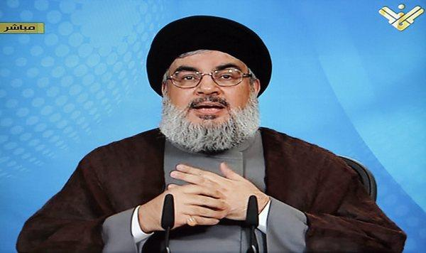 Hezbollah leader Hassan Nasrallah appears on television April 30 in Beirut to voice support for Syria's President Bashar Assad.