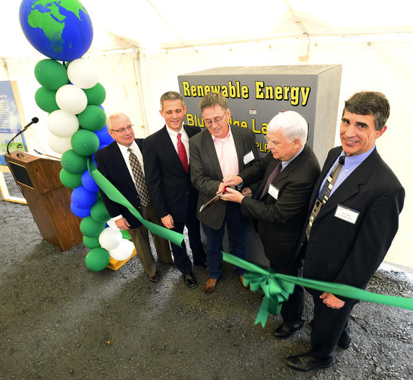 Ribbon-cutters Vito Galante, IESI regional vice-president, State Rep. Rob Kauffman, R-Franklin/Cumberland, William McLaughlin, Chambersburg Town Council president, C. Alan Walker, secretary of the Pennsylvania Department of Community and Economic Development, PPL Renewable Energy President Mike Kroboth are shown Tuesday at a dedication ceremony for the IESI Blue Ridge Landfill gas-to-energy power project.