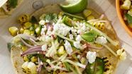 Charred Corn Tacos With Radish Zucchini Slaw combines the crunch of grilled corn with herbs and spring radishes. The dish is topped off with a squeeze of fresh lime juice and creamy cheese. Locally fresh sweet corn is available from Long & Scott Farms, 26216 County Road 448A, Mount Dora (near the Zellwood city limits). For details, call 352-383-6900