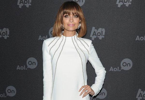 "Nicole Richie's tramp stamp is the subjected of her first webisode of ""#CandidlyNicole,"" a Web series from AOL."