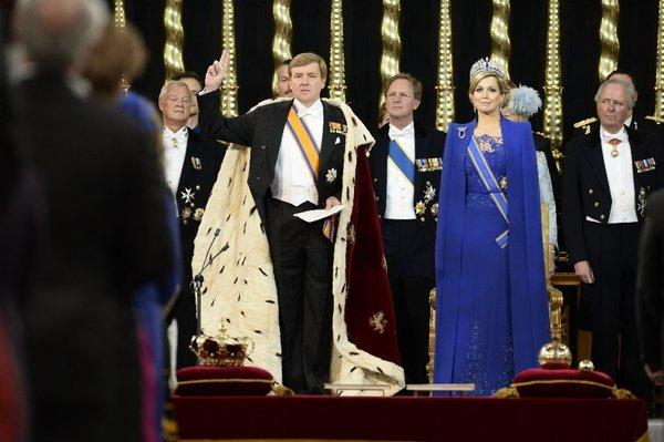 King Willem-Alexander of the Netherlands with his wife, Queen Maxima, during his swearing-in and investiture ceremony on Tuesday in Amsterdam.