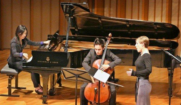 Rei Nakamura on piano, Jeremiah Campbell on cello and soprano Alice Teyssier at the Monday Evening Concert performance.