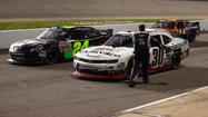 NASCAR has suspended the two Richard Childress Racing crew members arrested for fighting with Nelson Piquet Jr. at Richmond.