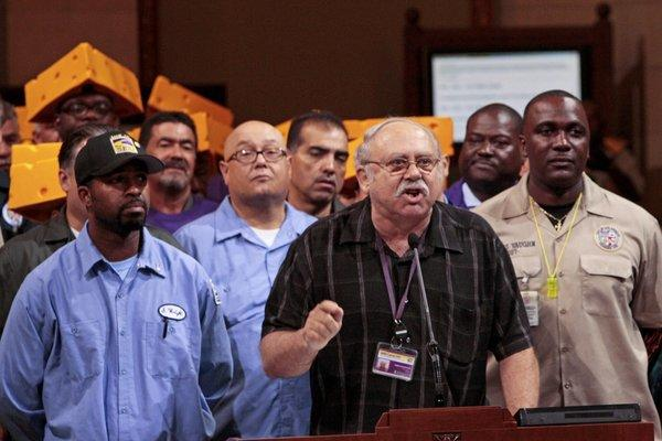 Surrounded by city workers in September, SEIU Local 721 President Bob Schoonover, center, addresses the Los Angeles City Council to protest cuts to future city workers' retirement and health benefits.