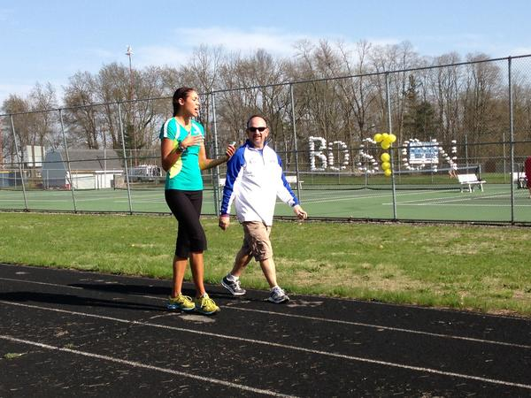 "Bethel College track coach Tony Natali, right, talks with track alum Leah Schwartz during Tuesday's ""Walk 4 Boston."""