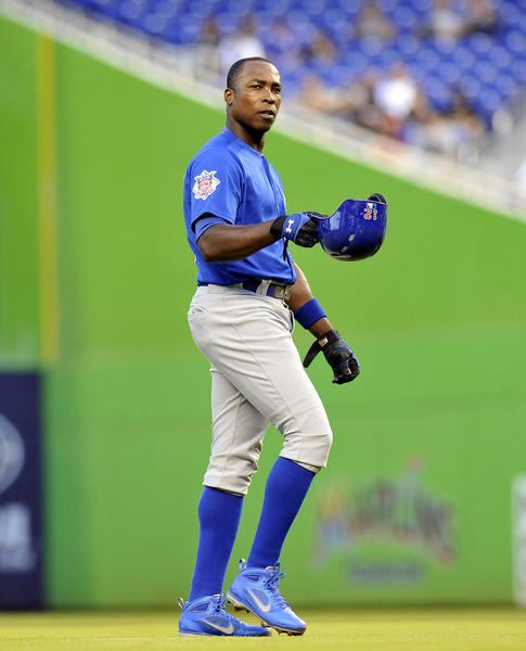 Alfonso Soriano takes off his batting helmet in the first inning against the Marlins.