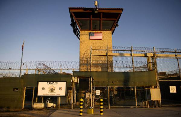 Of 166 prisoners at Guantanamo Bay, 100 are refusing to eat in a protest over their indefinite imprisonment without trial or prospect of release, military officials said. Many have been in custody for more than a decade.