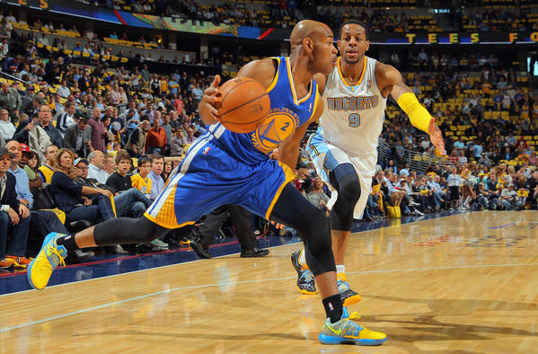 Jarrett Jack #2 of the Golden State Warriors controls the ball against Andre Iguodala #9 of the Denver Nuggets during Game Five of the Western Conference Quarterfinals of the 2013 NBA Playoffs at the Pepsi Center on April 30, 2013 in Denver, Colorado.