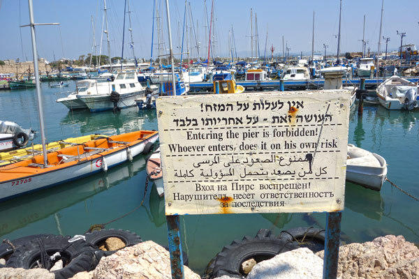 Signs in four languages are commonplace in Israel: Hebrew (for its Jewish population), Arabic (for the Israeli Arabs — about a quarter of the country), Russian (as many locals are recent Jewish arriva