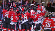 A man of few words, and front teeth, Bryan Bickell flashed a smile only a hockey mom could love Tuesday night, summing up how it felt to score the winning goal in the Blackhawks' 2-1 overtime victory over the Wild.