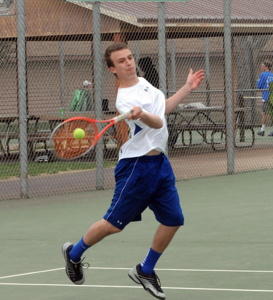 Aberdeen Central's Aaron Lorenz returns a serve during his match with Nathan Ellenbecker at Tuesday's triangular with Pierre. (Wade LaRoche/Capital Journal)