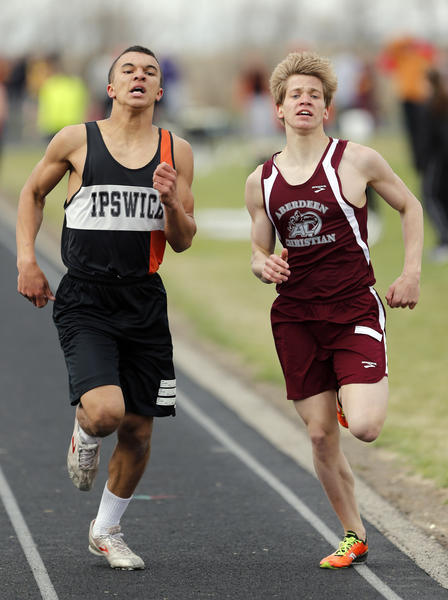 Danzan Gilborne, of Ipswich, left and Tucker Iwerks, of Aberdeen Christian, sprint for the finish of the boys 1600 meter run at the Lake Region Conference track meet in Ipswich Tuesday. American News Photo by John Davis
