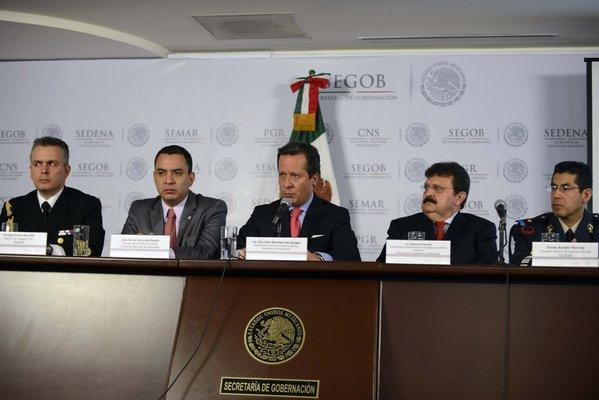 "From left to right, Mexican Navy Capt. Enrique Ponce de Leon, National Commission of Security media director Carlos Cervantes, the under-secretary of media for the Interior Ministry, Eduardo Sanchez, the under-attorney for organized crime, Cleominio Soreda, and Mexican Army Lt. Col. Tomas Amador, attend a press conference Tuesday in Mexico City on the capture of Ines Coronel Barrera, father-in-law and associate of drug kingpin Joaquin ""Chapo"" Guzman."