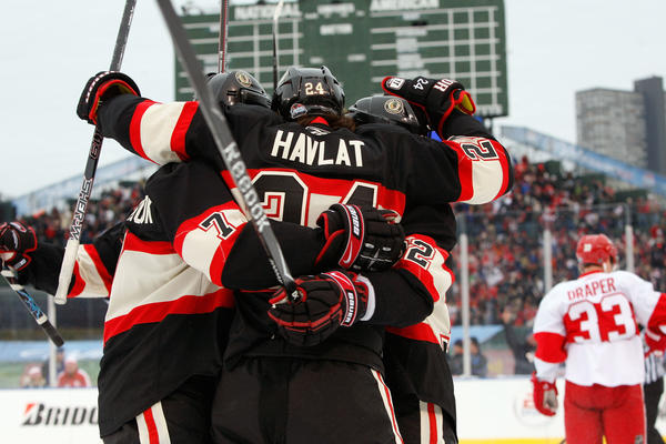 Chicago Blackhawks players celebrate a goal during the 2009 game against Detroit at Wrigley Field.