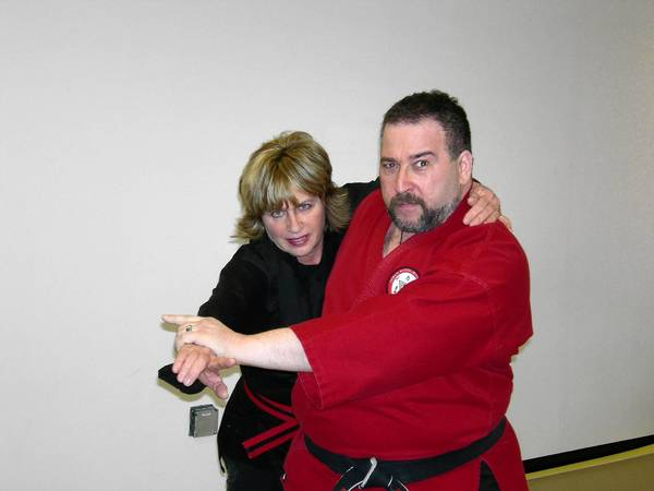 Ross Greenberg (Right) and Terre Theis (Left) practice a move at their new martial arts school in Plainfield.