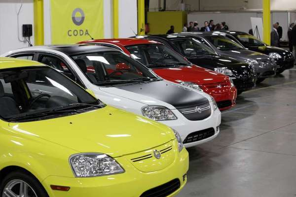 Chinese-manufactured electric Coda vehicles are unveiled in November 2011. The Los Angeles-based company, backed by billionaire Philip Falcone, has filed for bankruptcy.