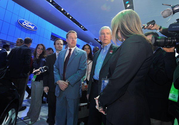 Bill Ford Jr., executive chairman, Ford Motor Company, left, and Michigan governor Rick Snyder, right, visit the Ford display at the 2013 Detroit Auto Show in January.