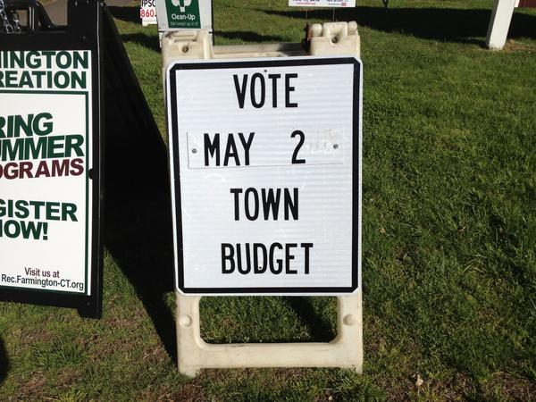 A sign reminding residents to vote on the recommended $92 million budget on Thursday, May 2.