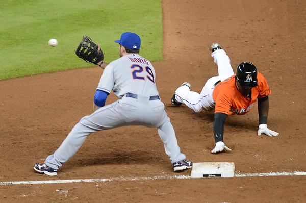 MIAMI, FL - APRIL 30:  First baseman Ike Davis #29 of the New York Mets attempts to pick off Marcell Ozuna #48 of the Miami Marlins at Marlins Park on April 30, 2013 in Miami, Florida.  (Photo by Jason Arnold/Getty Images) ORG XMIT: 163493372