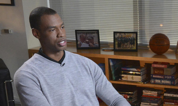 NBA basketball player Jason Collins (L), the first openly gay active athlete on a major U.S. professional sports team, sits for an interview with ABC News George Stephanopoulos.
