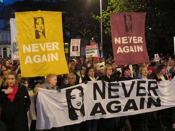 This file photo from Nov. 17 shows abortion rights protesters holding pictures of Savita Halappanavar as they march through Dublin, demanding Ireland's government ensures abortions can be performed to save a woman's life.