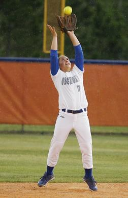 Osceola High's Morgan Crapo makes a catch as the rain falls during the Osceola High at Harmony High School softball game in St. Cloud on Tuesday, April 30, 2013. (Stephen M. Dowell/Orlando Sentinel)