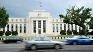 Federal Reserve officials stay course on stimulus, interest rates