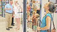 The multipurpose room at Jessamine Career and Technology Center became a countywide art gallery Tuesday night as hundreds filed through to look at artwork of all kinds from students of all ages.