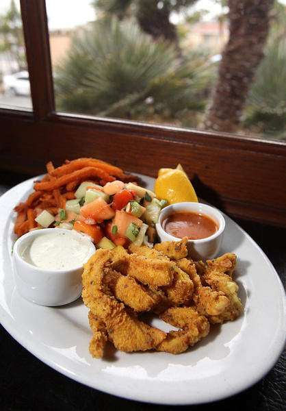 The savory and thick fried calamari with sweet potato fries at Mozambique in Laguna Beach.