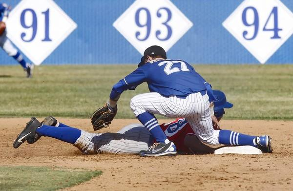 Fountain Valley's Dillon Persinger applies the tag to a Los Alamitos baserunner at second base during last week's game.