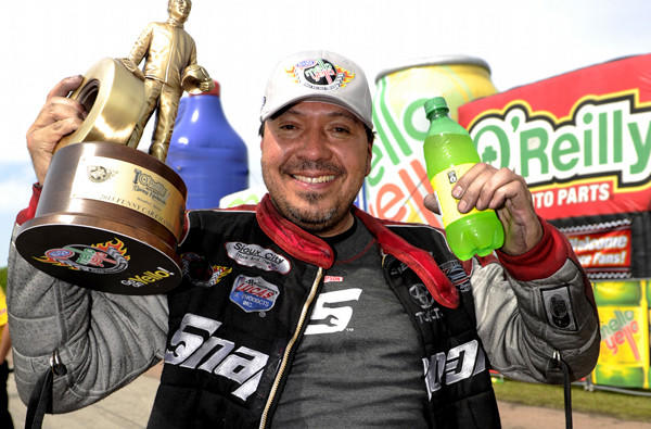 Cruz Pedregon celebrates his second Funny Car victory of the season in the OReilly Auto Parts NHRA SpringNationals at Royal Purple Raceway in Baytown, Texas.