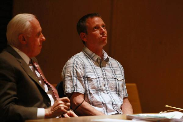 Timothy Morrow and defense attorney Mike Norris, left, listen to the judge Wednesday during Morrow's sentencing hearing for his eighth DUI conviction.