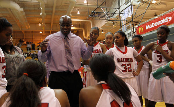 Bolingbrook head coach Anthony Smith talks to his team in a game against Niles West during McDonald's Shootout at Willowbrook on Monday, Jan. 16, 2012.