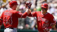 OAKLAND -- C.J. Wilson survived a rocky start, Howie Kendrick, Mike Trout and Mark Trumbo each hit solo home runs, and Ernesto Frieri came through with a five-out, 35-pitch save Wednesday, as the Angels snapped a four-game losing streak with a 5-4 victory over the Oakland Athletics.
