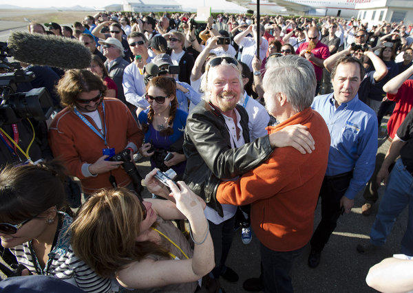 Richard Branson hugs designer Burt Rutan during a test flight of SpaceShipTwo in Mojave.