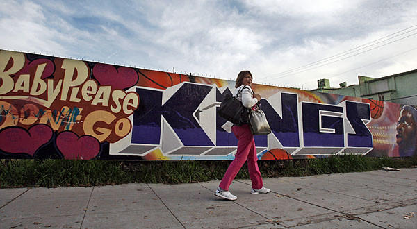 A mural in downtown Sacramento virtually begs the Maloof family, the owners of the Sacramento Kings, to keep the team in town.