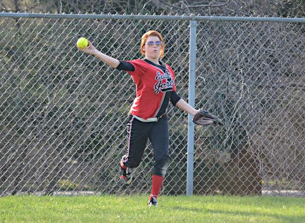 East Jordan's Tori Goodrich throws the ball back into the infield from leftfield during the Red Devils game against Charlevoix Tuesday in East Jordan.