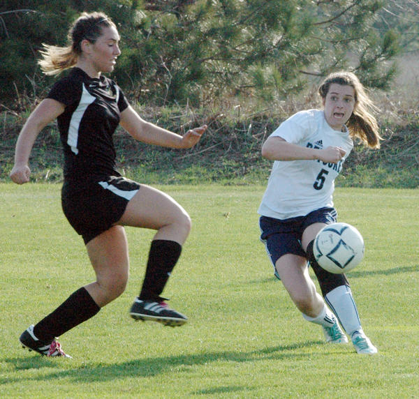 Petoskey senior Liz Fraser (right) scored the Northmen's lone goal Tuesday as they played to a 1-1 tie with Traverse City Central in a Big North Conference match at the Click Road Soccer Complex.