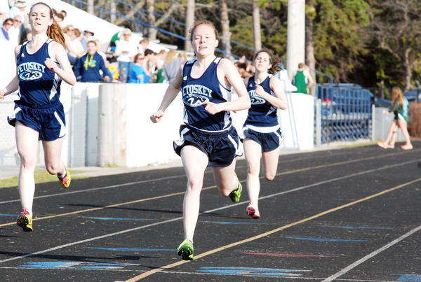 Petoskey sophomore Sara Slack (right) crosses the finish line during the 200-meter dash during Tuesdays Big North Conference dual meet with Traverse City West at Curtis Field. Slack won the race in 29.20 seconds, while Rachel Schulingkamp (left) was second and Sage Charlebois (far right) was third.
