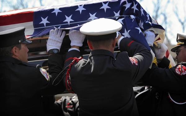 After funeral services Wednesday at Sacred Heart Church in Palos Hills, firefighters carry out the casket of Kevin Sanders, a first responder killed in the fertilizer plant explosion in West, Texas, last month.