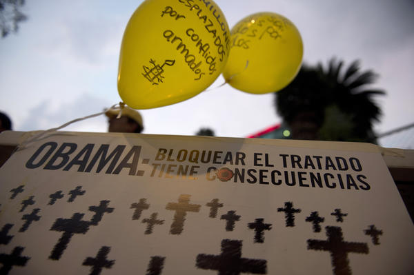Activists of Amnesty International hold a protest in front of the U.S. Embassy in Mexico City. Dozens of activists demand that President Obama assume a responsible role in the negotiations of a Treaty on Arms Trade.