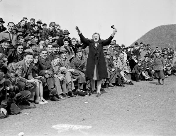 Hilda Chester, the Brooklyn Dodgers' self-styled No. 1 fan, rings a bell before a crowd of fans in Bear Mountain, N.Y. during an exhibition game on March 29, 1943.