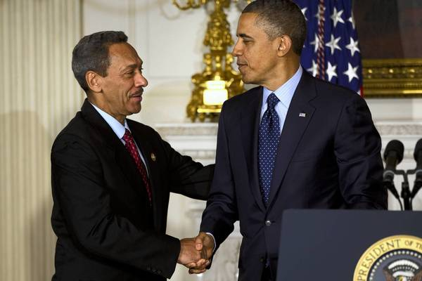 President Obama shakes hands with Democratic Rep. Mel Watt, his nominee to head the Federal Housing Finance Agency.