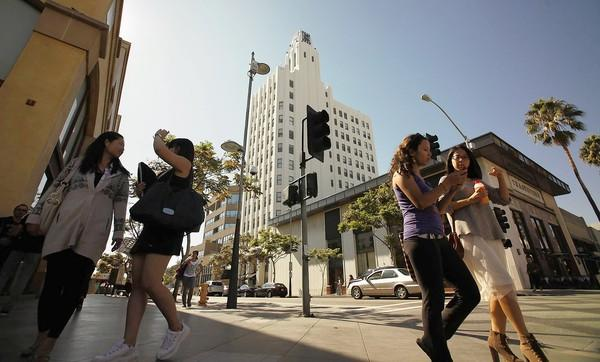 The Clock Tower building in Santa Monica is seen in the background. The historic building, completed in 1929, commands some of the highest rents in Southern California.